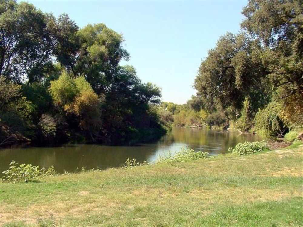 A view of the winding river at MERCED RIVER RV RESORT