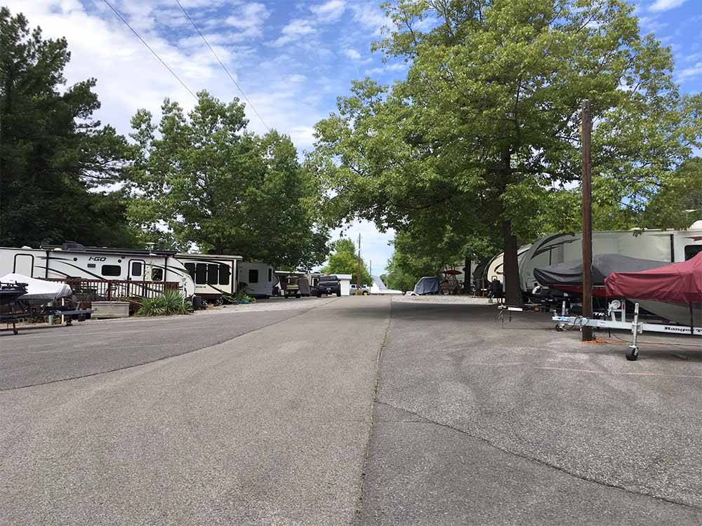 A road with RVs running along both sides at MURPHYS OUTBACK RV RESORT