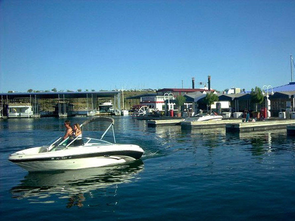 Couple boating at PLEASANT HARBOR MARINA  RV RESORT
