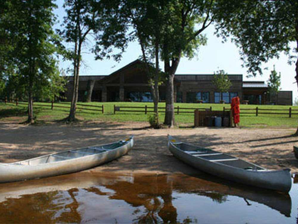 Canoes on the water at WISCONSIN RIVERSIDE RESORT