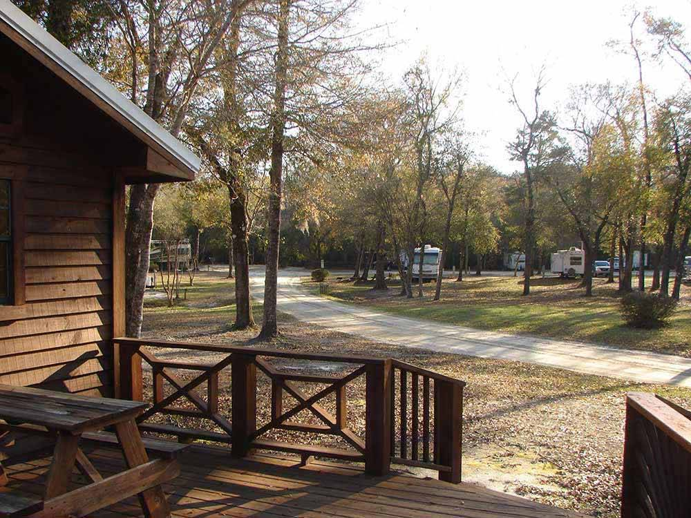 Cabin with deck at RIVERS EDGE RV CAMPGROUND