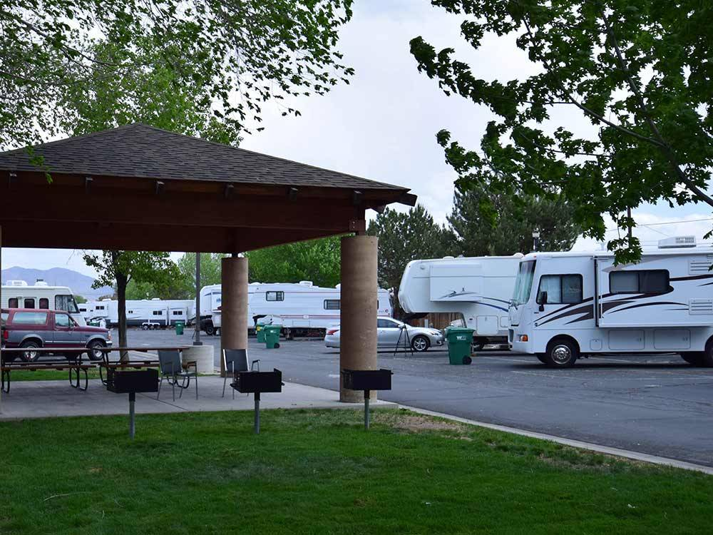 Patio and RVs and trailers at SILVER SAGE RV PARK