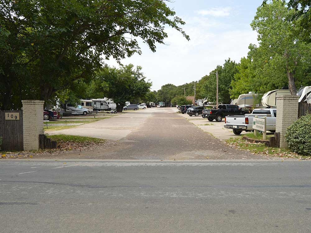 Road leading into campgrounds at POST OAK PLACE RV PARK