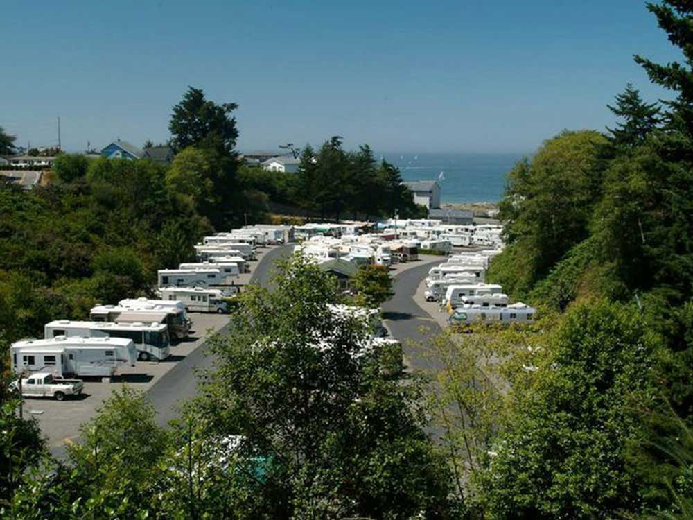 View of RV park and ocean beyond at DRIFTWOOD RV PARK