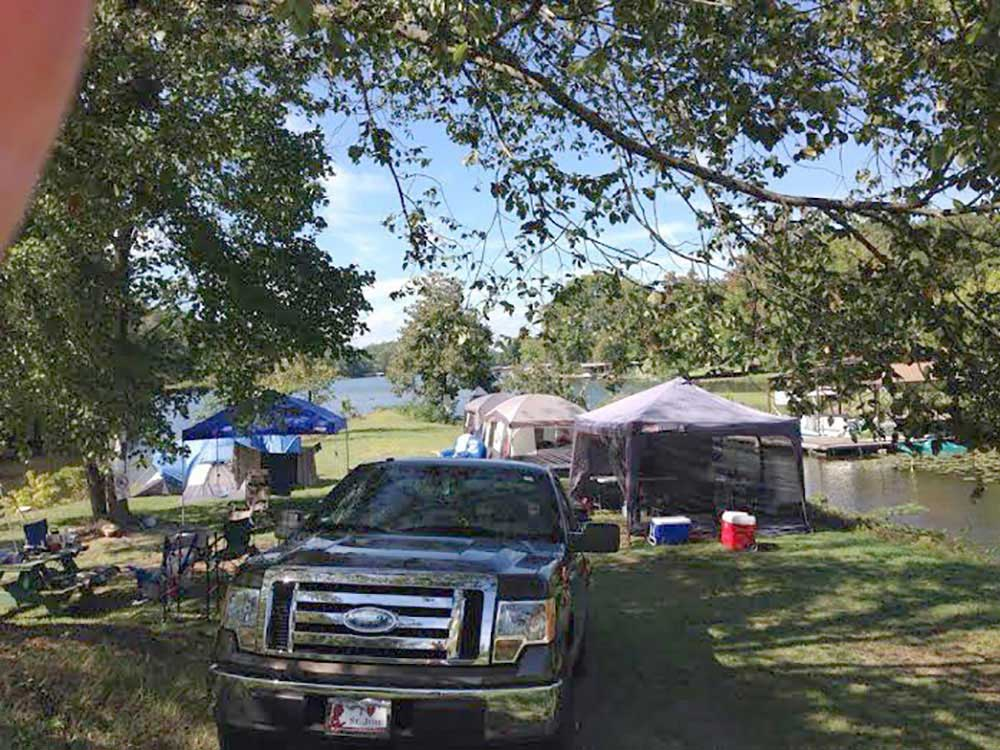 Tents camping at YOUNGS LAKESHORE RV RESORT