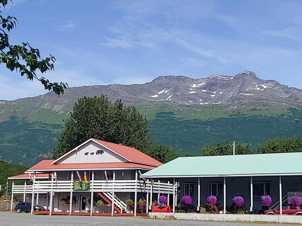 Office and building with mountain in the background at BEAR PAW ADULT PARK