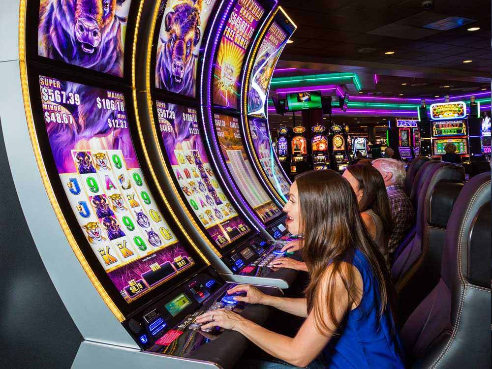 People playing on the slots at COUSHATTA LUXURY RV RESORT AT RED SHOES PARK