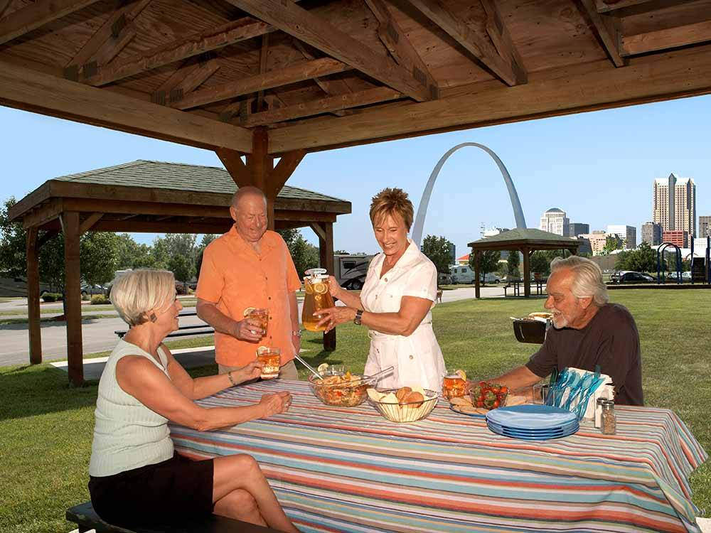 An elderly couple sitting in the doorway of their motorhome at CASINO QUEEN RV PARK