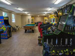View larger image of Pool table and arcade gaming zone at CAMP RIVERSLANDING image #2