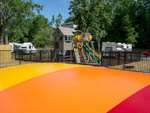 View larger image of Playing area for children with large bouncing pad at CAMP RIVERSLANDING image #4
