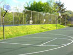 View larger image of Side by side basketball courts with tennis courts in background at CAMP RIVERSLANDING image #9