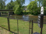 View larger image of Pet waste area and beautiful bridge by a canal at CAMP RIVERSLANDING image #11
