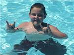 View larger image of Man relaxing in hammock at MAPLE LAKES RECREATIONAL PARK image #6