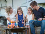 View larger image of Children roasting marshmallows with their parents at INDIANA BEACH CAMPGROUNDS image #2
