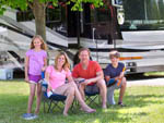 View larger image of Family outside their RV at INDIANA BEACH CAMPGROUNDS image #8