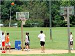 View larger image of Kids playing basketball at LAKE GASTON AMERICAMPS image #8