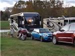 View larger image of Mini Cooper motorcycle and RV at GREENVILLE FARM FAMILY CAMPGROUND image #3
