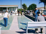 View larger image of Folks outdoors playing shuffleboard at HO HO KAM RV PARK image #10