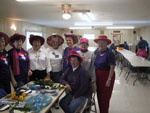 View larger image of Ladies in hats with flowers in community party room at HO HO KAM RV PARK image #11