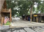View larger image of Stores with American flags and Grizzly Den at PONDEROSA CAMPGROUND image #5
