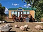 View larger image of One of the yellow camping cabins at OASIS RV RESORT  COTTAGES - DURANGO image #3