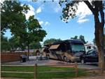 View larger image of RV and truck at campsite at GRAND JUNCTION KOA image #4