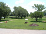 View larger image of Outdoor seating area with bench well and picnic table at PRAIRIE OASIS CAMPGROUND  CABINS image #2