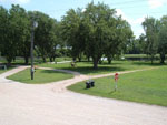 View larger image of Outdoor seating area with stop sign and picnic table at PRAIRIE OASIS CAMPGROUND  CABINS image #3