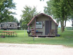 View larger image of Log Cabin with picnic table at PRAIRIE OASIS CAMPGROUND  CABINS image #6