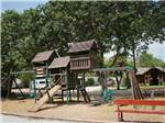 View larger image of Playground with swing set at AUSTIN LONE STAR RV RESORT image #4