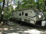 View larger image of Trailer camping at campsite at BEAR DEN FAMILY CAMPGROUND AND CREEKSIDE CABINS image #4