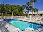 View larger image of Swimming pool with outdoor seating at ORANGE GROVE RV RESORT image #1