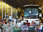 View larger image of People sitting in chairs next to a RV at ORANGE GROVE MOBILE HOME  RV PARK image #2