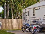 View larger image of Motorcycle parked next to RV at ORANGE GROVE MOBILE HOME  RV PARK image #3