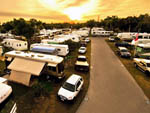 View larger image of RVs and truck and trailers camping at ORANGE GROVE MOBILE HOME  RV PARK image #4