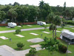 View larger image of An aerial view of some empty paved RV sites at ORANGE GROVE MOBILE HOME  RV PARK image #8