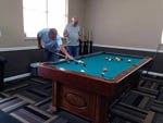 View larger image of A couple of old men playing pool at ORANGE GROVE MOBILE HOME  RV PARK image #9