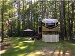 View larger image of  A fifth wheel trailer parked in a wooded RV site at WAKEDA CAMPGROUND image #7
