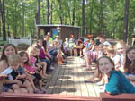 View larger image of Kids and parents outdoors at campground at TIMBERLAND LAKE CAMPGROUND image #9