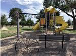 View larger image of Playground with yellow slides at AREAS FINEST COUNTRY VIEW CAMPGROUND image #2