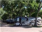 View larger image of RVs and truck and trailers camping at LOVELAND RV RESORT image #7