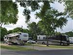 View larger image of RVs and truck and trailers camping at TRAVELERS WORLD RV RESORT image #3