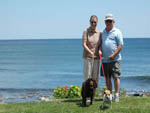 View larger image of Couple walking dogs with ocean view at LIBBYS OCEANSIDE CAMP image #7