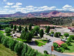 View larger image of Aerial view of park with distant mountains at WONDERLAND RV PARK image #1