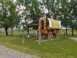 View larger image of Covered wagon and hitching post at WONDERLAND RV PARK image #3