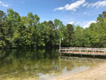 View larger image of Boat dock on the water at WHISPERING PINES RV PARK image #2