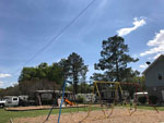 View larger image of Playground with swing set at WHISPERING PINES RV PARK image #4