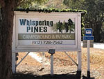 View larger image of Sign leading into campground at WHISPERING PINES RV PARK image #9