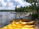 View larger image of Yellow kayaks and boats on the lake at PATTEN POND CAMPING RESORT image #3