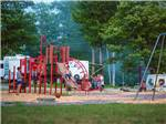 View larger image of Playground with swing set at PATTEN POND CAMPING RESORT image #8